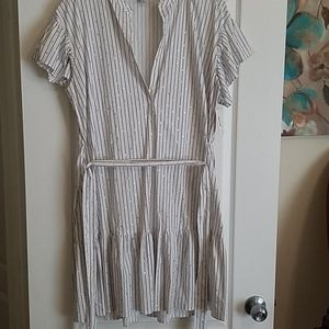 A white dress with silver circles design.